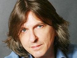 GIANNI TOGNI, cantautore, 53 anni
